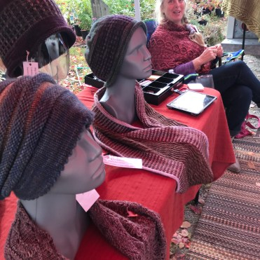 Shawls and caps knitted with hand-dyed wool