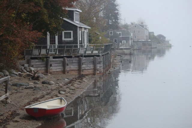 One red boat stands ready on a foggy morning in Castine.