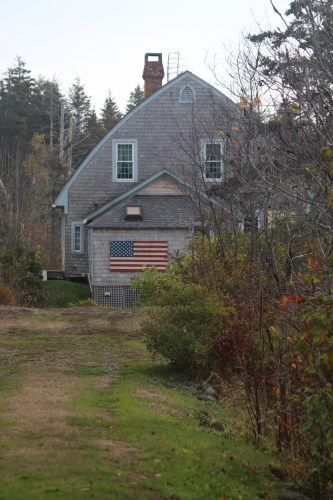 Gray Cape Cod home with American flag -- on the way to Lobster Cove.