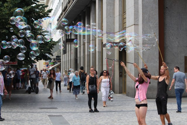 Bubble blowers on the sidewalks of Prague.