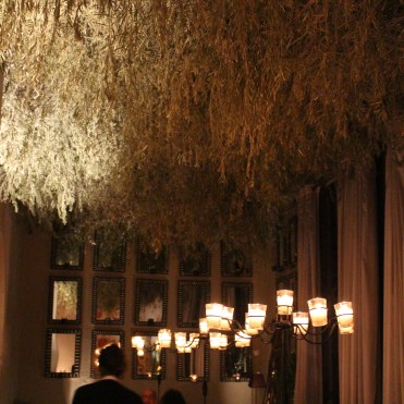 Branches woven into a grid adorn the ceiling of the dining room at Jnane Tamsna.