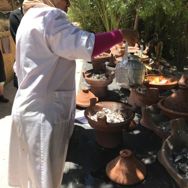 Chef Bahija adding water to the individual tagines.