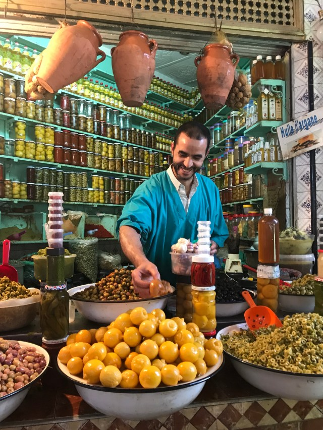 Olives, lemons, spices, and preserves -- a colorful stall in the Marrakech medina.