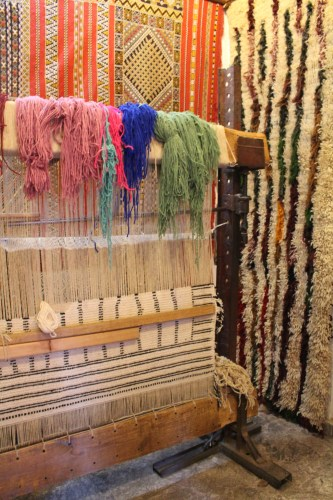 Waiting for someone to come back to the loom at a Marrakech rug shop.
