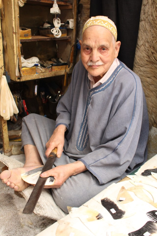 A craftsman in Fes uses his feet to shape bone into creative combs.
