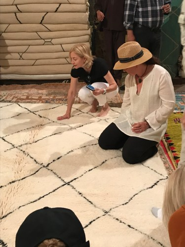 Two California ladies shop for Moroccan rugs.