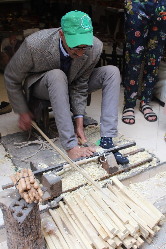 Wood turner in Marrakech medina working with his feet!