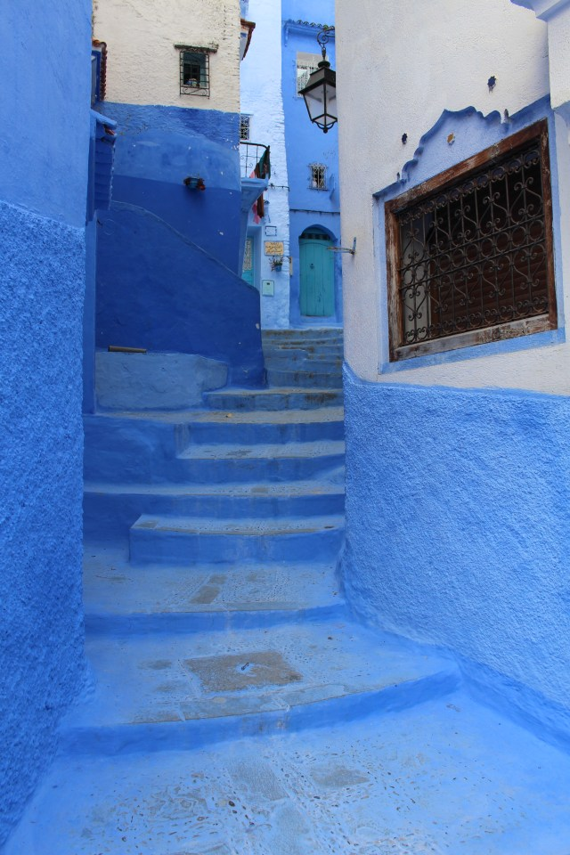 Blue steps lead to a blue door at a residence in Chefchaouen.