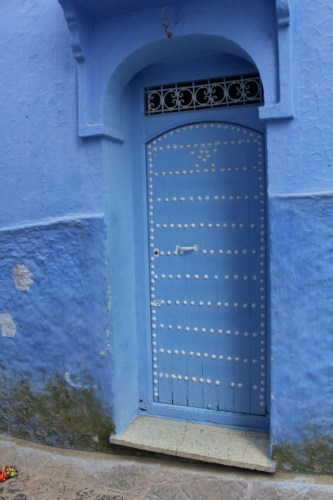 Blue door with metal detail