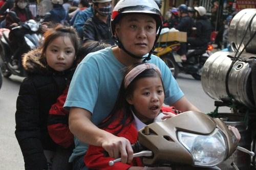 Hanoi traffic, family on motorcycle