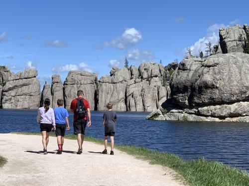 Family walking through Sylvan Lake sams