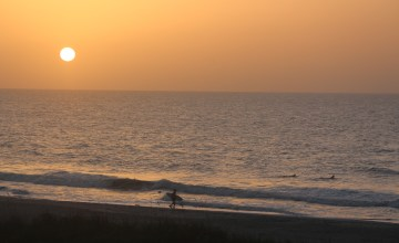 Sunrise with surfer -- Pawleys Island SC