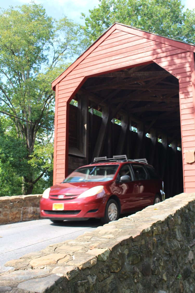 Car exiting Loys Station Covered Bridge