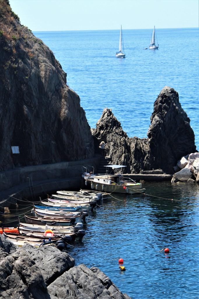 Boats tethered along the rocks of Manarola's coastline