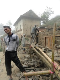 While stone masons stand on bamboo poles to build the wall higher, one of the workers in Nepal talks about what we should do next.