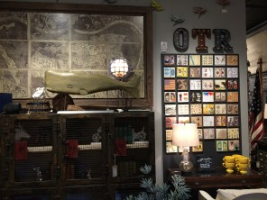 Wall maps and metal letters at Elm & Iron OTR