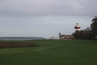 The long greens of Harbor Town Links stretch down to the lighthouse on Hilton Head Island.