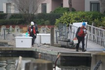 Workers arrive at Harbor Town ready to repair the damage