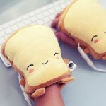 Smiling Toast Heated Handwarmers