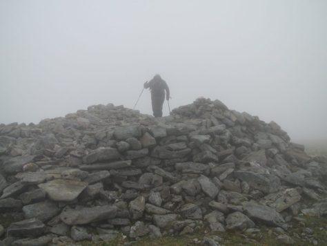 Summit cairn of Ben Alder, in the mist
