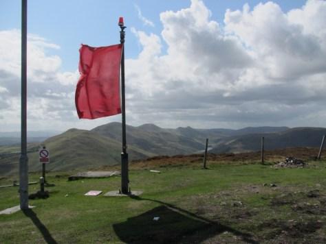 Warning flag on summit of Castlelaw Hill
