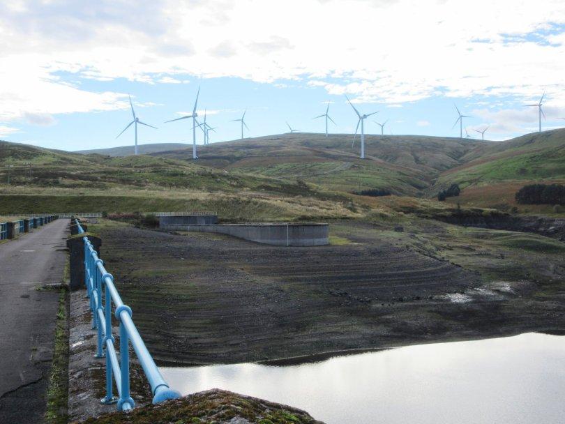 Low water in Upper Glendevon Reservoir, Burnfoot Hill Wind Farm beyond