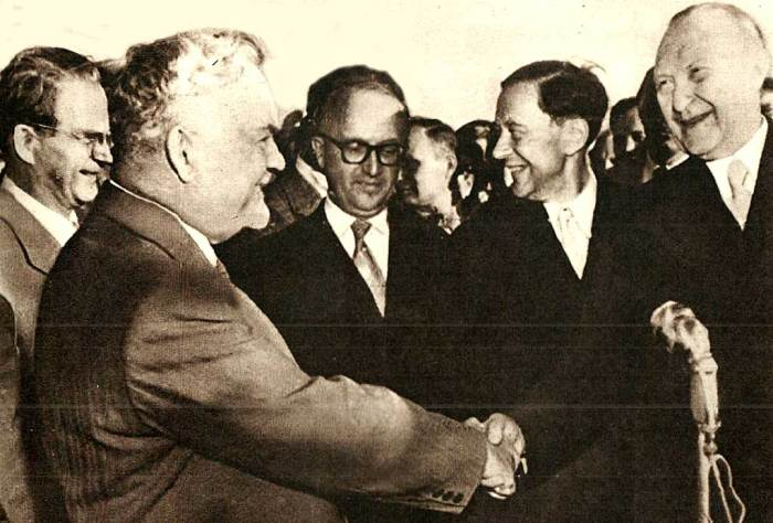 Reach Out And Touch Someone. Adenauer (r) meets Bulganin (l) on his arrival in Moscow .