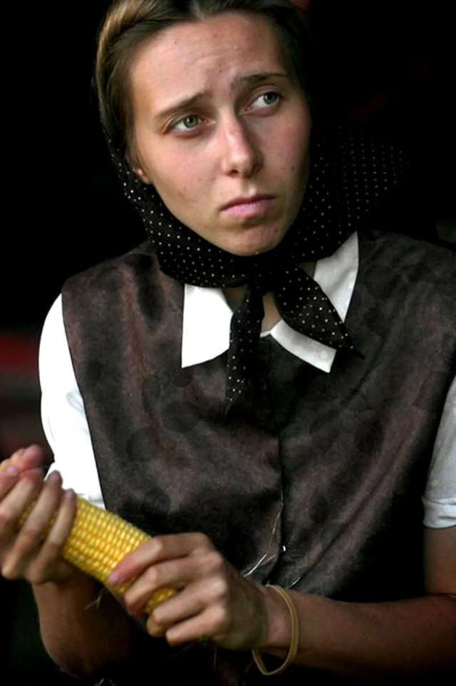 A Hutterite husking corn - the all-encompassing America is often at odds with itself.