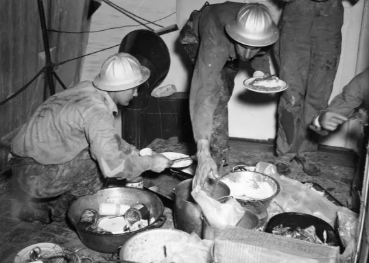 Stellar Amenities: Halliburton workers prepare a well deserved meal early 1950s