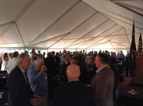 A shot of folks socializing under the presentation tent before the Grand Opening celebration.