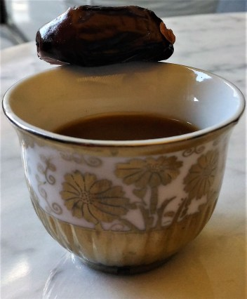 Strong Arabic coffee with a date