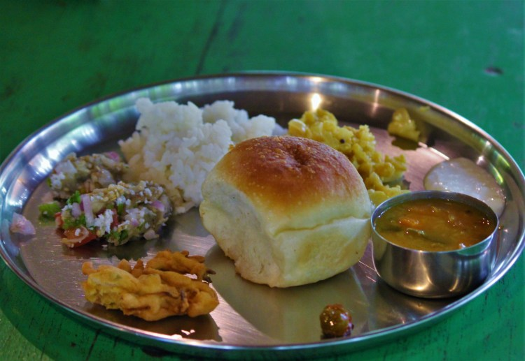 A hearty Goan meal of pao, rice and curries with plenty of coconut