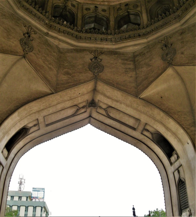 I look up at the old city from Charminar's intricately done gate.