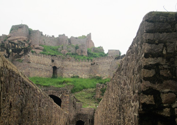 I pass through a tunnel as I explore the labyrinthine Golconda Fort.