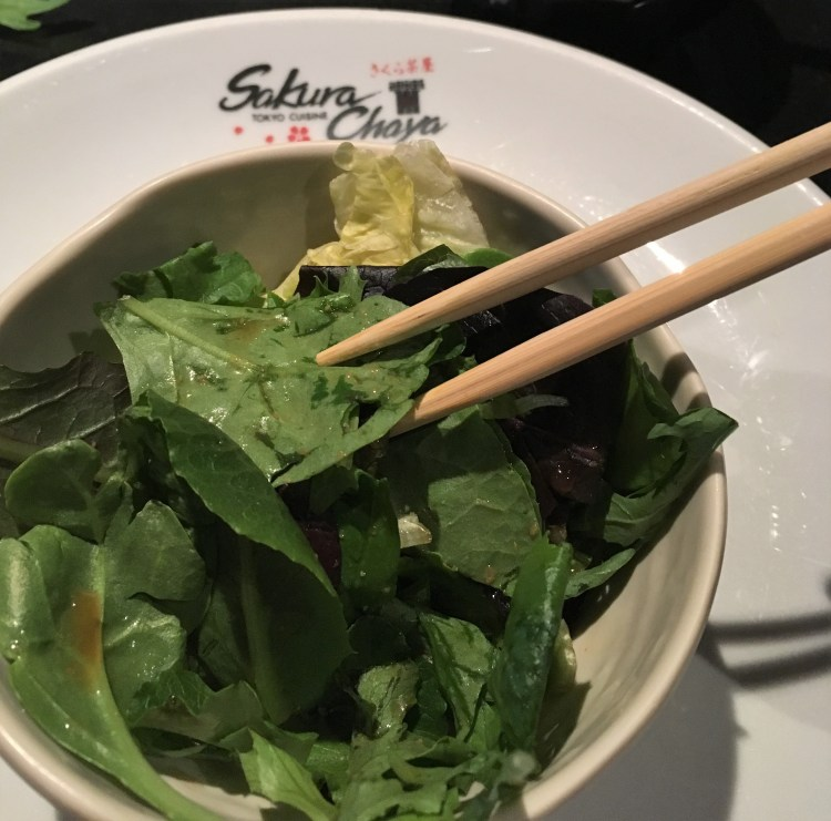I finish my bowl of greens with chopsticks at a Teppanyaki restaurant in California.