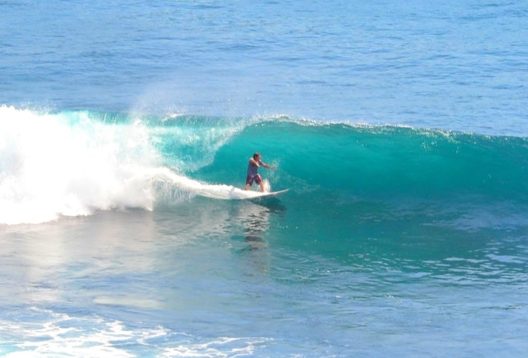 Surfer at Uluwatu in Bali (Courtesy: Simon Sees)