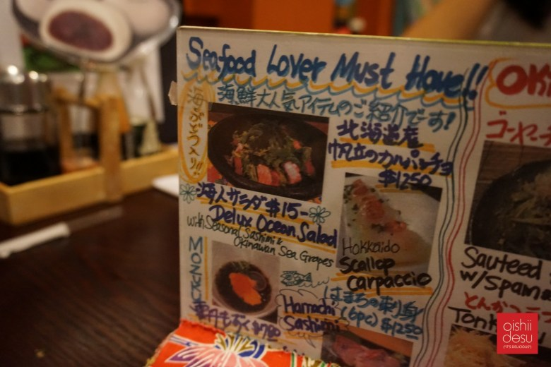 Photo Description: one of the table top menu's which highlights Mayui'san's artistic abilities.
