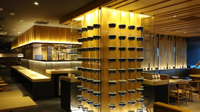 Photo Description: Tainan City, Taiwan Santouka Ramen interior. The interior is a posh golden interior which is the color given off by the light colored wood.