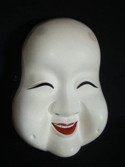 Okame mask, one of the design elements seen in the restaurants