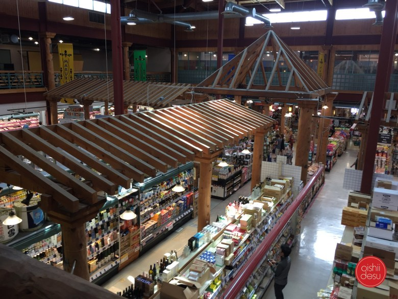 Photo Description: I took this pic of Marukai from the upper floor of this MASSIVE Japanese supermarkets which looks like a village of sorts inside due to the wooden roofed structures throughout the interior. Below you can see the shelves upon shelves of products that stretch from wall to wall.