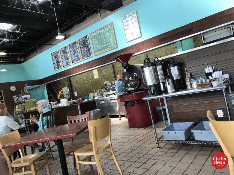 Photo Description: Common Grounds in the Sunnyside area is  depressing and sad looking interior that looks like a rummage sale of old random chairs, generic looking tile block flooring, a drab looking backsplash, all surrounded by a baby blue upper interior wall color.