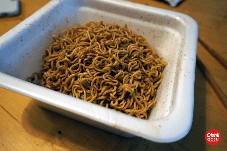 Photo Description: the noodles after they have been doused in the darker sauce.
