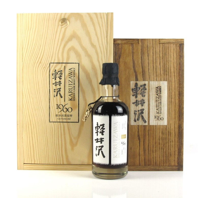 """Photo Description: this is the most famous or infamous of all the Japanese whiskeys featured. It is from teh Karuizawa distillery which is no longer around and they shut down in 2000-2001. The images is of the bottle and the natural wood finish boxes taht it came in. Printed on the box is their logo, along with the text """"Karuizawa single cask malt whisky."""" Along with """"1960"""" and the cask number."""