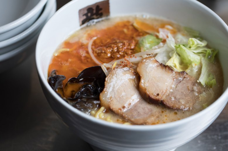 Photo Description: a bowl of ramen from Tatsunoya ramen which specializes in tonkotsu (pork) ramen. There are two pieces of pork belly chashu, along with kikurage, and what looks like cabbage and moyashi (bean sprouts).