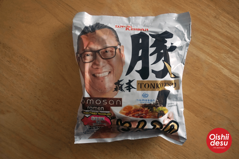 Photo Description: this is my shot of the tonkotsu ramen packaging. It's kind of wrinkled, but you an see the packaging which is almost wrapped around the round block of ramen noodles.