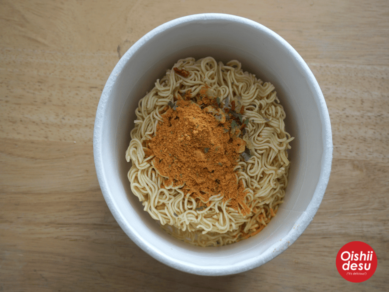 Photo Description: two of the packets out of the three atop the noodles in the very large bowl.