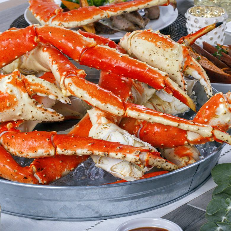 Photo Description: if this pic does not make you want crab, I don't what will because in giant metal pales filled with ice lay a bunch of Alaskan king crab legs. In the pic you can see a number of claws. This shot is by Maine Lobster Now.