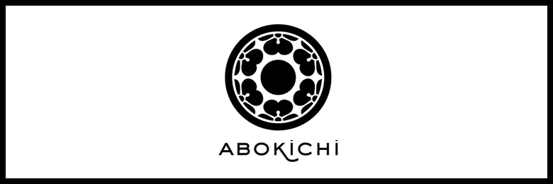 Photo Description: the Abokichi logo which is a circular black and white logo.