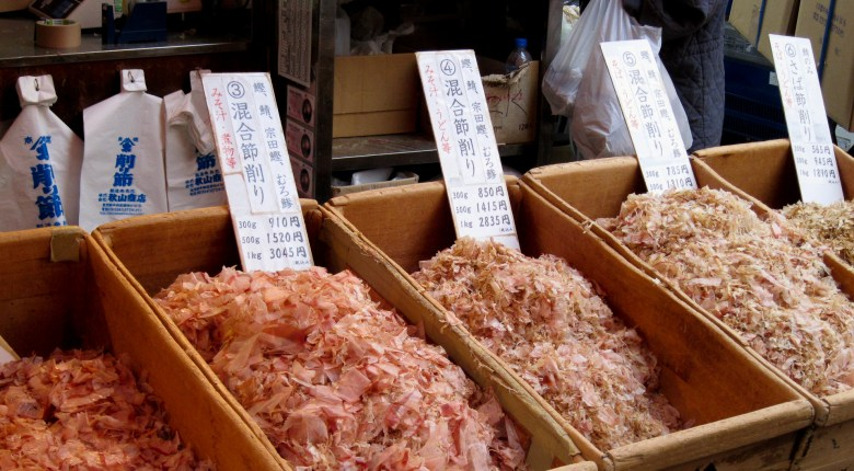 Photo Description: several wooden bins contain a number of varieties of katsuobushi. The fermented and hardened fish fillets are shaved into paper thin shavings.