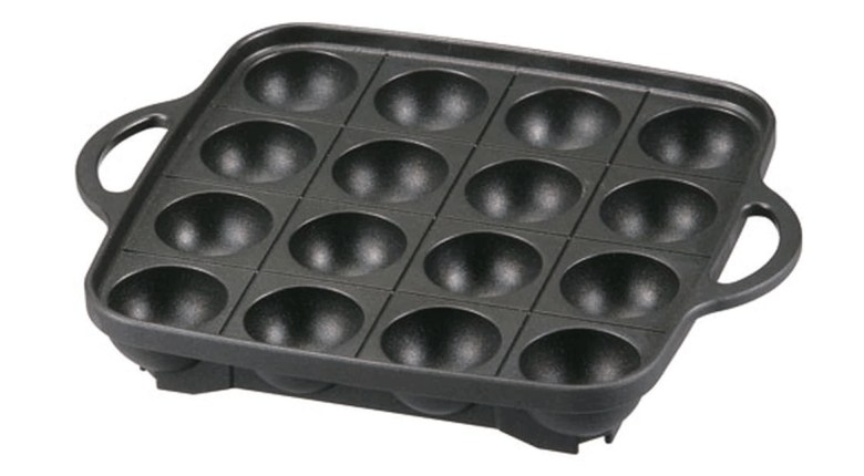 """Photo Description: Iwatani aluminum alloy non-stick takoyaki pan that fits on a butane/gas burner. There are notches that allow you to """"fix"""" the pan into place with no fear of it falling off."""